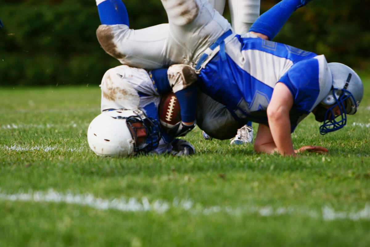 High School Football Player Files Lawsuit After Life-Altering Concussion