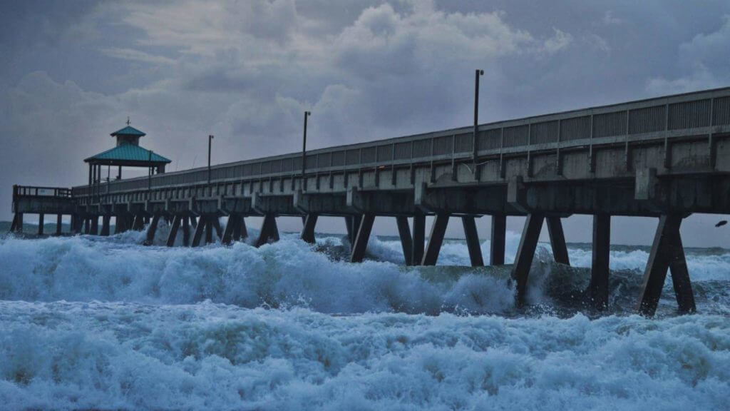 Raised dock bridge on a stormy day over frothy water